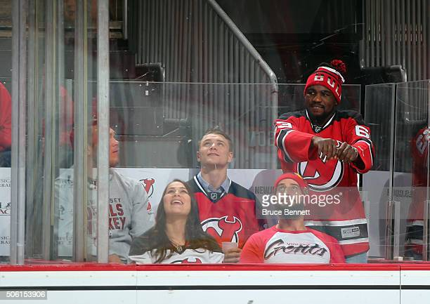 Forrest Griffin Jessica Eye Chris Wade CM Punk and Corey Anderson from the UF take in the game between the New Jersey Devils and the Ottawa Senators...