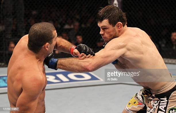 """Forrest Griffin punches Mauricio """"Shogun"""" Rua during a light heavyweight bout at UFC 134 at HSBC Arena on August 27, 2011 in Rio de Janeiro, Brazil."""
