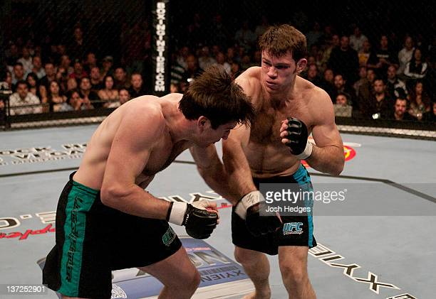 Forrest Griffin punches Stephan Bonnar during the Light Heavyweight Final bout during the live Ultimate Fighter Season Finale at the Cox Pavilion on...