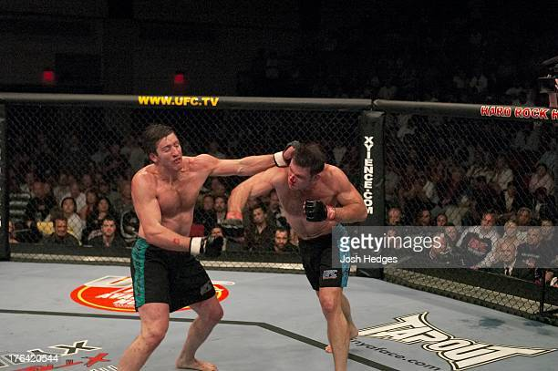 Forrest Griffin punches Stephan Bonnar during their light heavyweight finals bout at The Ultimate Fighter Season 1 Finale inside the Cox Pavilion on...