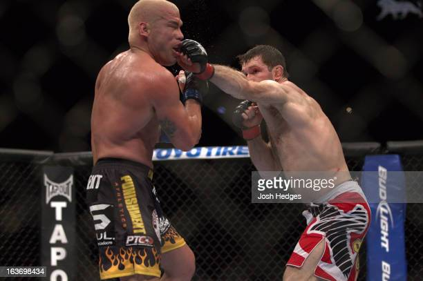 Forrest Griffin punches Tito Ortiz during their light heavyweight bout at UFC 148 inside MGM Grand Garden Arena on July 7, 2012 in Las Vegas, Nevada.