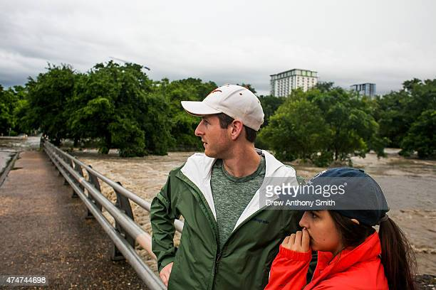 Forrest Huggleston and Alex Huff watch flooding at Shoal Creek after days of heavy rain on May 25 2015 in Austin Texas Texas Gov Greg Abbott toured...
