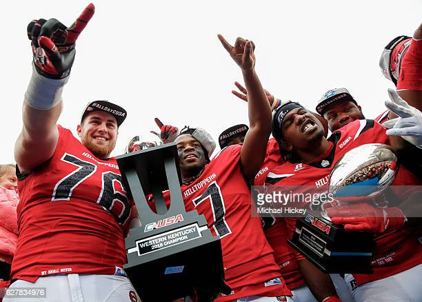 Forrest Lamp Tyler Ferguson and Anthony Wales of the Western Kentucky Hilltoppers celebrate following the game against the Louisiana Tech Bulldogs at...