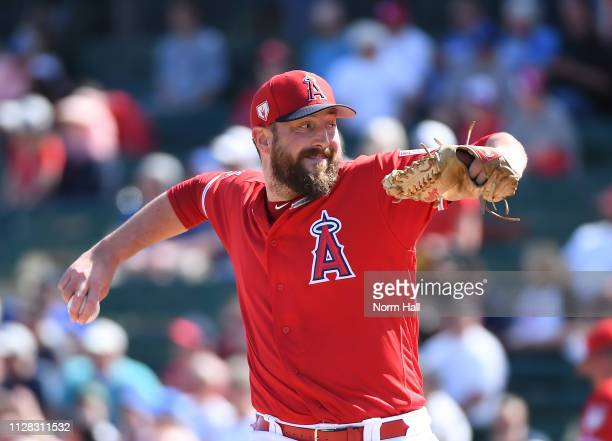 Forrest Snow of the Los Angeles Angels of Anaheim delivers a first inning pitch during a spring training game against the Kansas City Royals at Tempe...