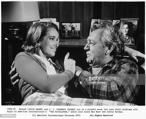 Forrest Tucker and Julie Adams are playful in a scene for the movie The Wild McCullochs circa 1975