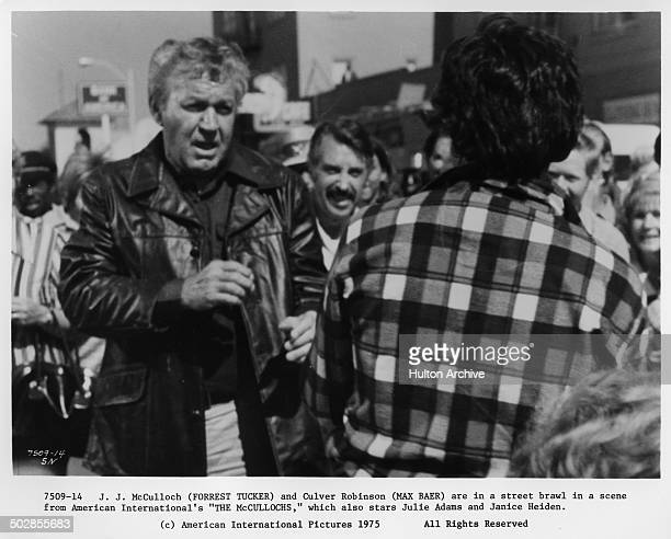 """Forrest Tucker and Max Baer Jr. Have a street fight in a scene for the movie """"The Wild McCullochs"""" circa 1975."""