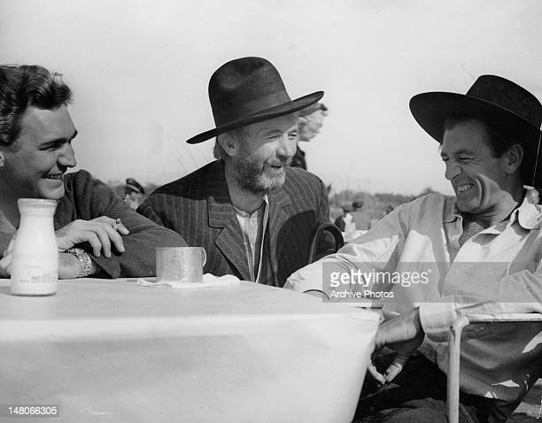 Forrest Tucker Walter Brennan and Larry Cooper just finishing lunch and laughs in a scene from the film 'The Westerner' 1940