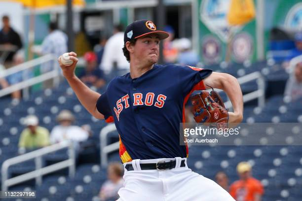 Forrest Whitley of the Houston Astros throws the ball against the New York Mets during a spring training game at The Fitteam Ballpark of the Palm...