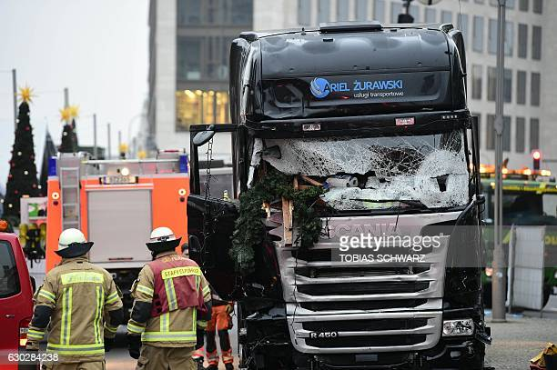 Forsenics and police work on the truck that crashed the evening before into a christmas market at Gedächtniskirche church on early December 20 2016...