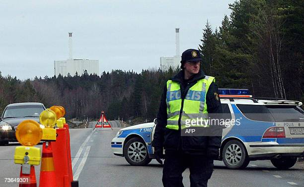 Police stand guard at the main road to the Forsmark Nuclear power plant north of Stockholm Sweden after a bomb threat 21 March 2007 Swedish police...