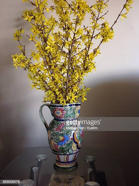 Forsythia Bouquet In Vase On Table