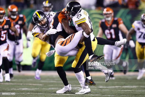 J Fort and Artie Burns of the Pittsburgh Steelers tackle AJ Green of the Cincinnati Bengals during the second half at Paul Brown Stadium on December...