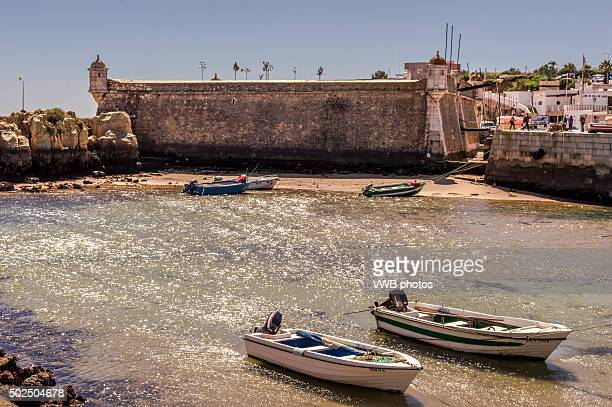 Fort and harbour with boats, Lagos, Portugal