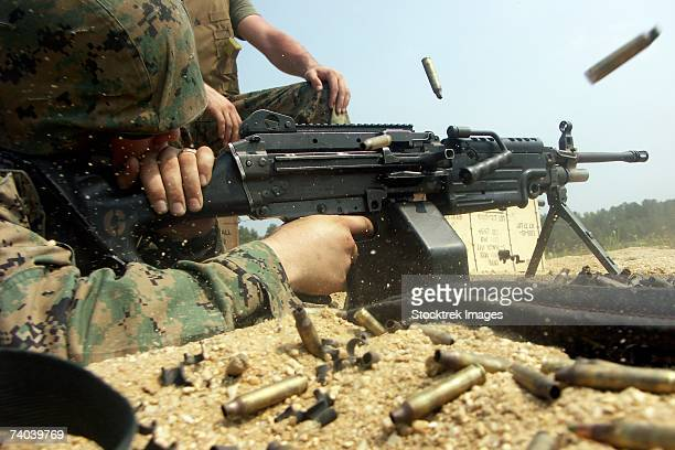 Fort A.P. Hill, Virginia - A Marine engages targets with an M-249 Squad Automatic Weapon during a live-fire exercise on the machine gun range.