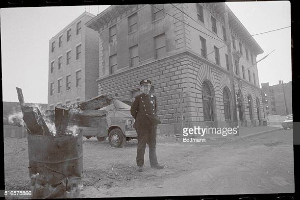 A policeman warms himself outside 'Fort Apache' a police station house sitting at the center of what was once one of the bloodiest and crimeridden...