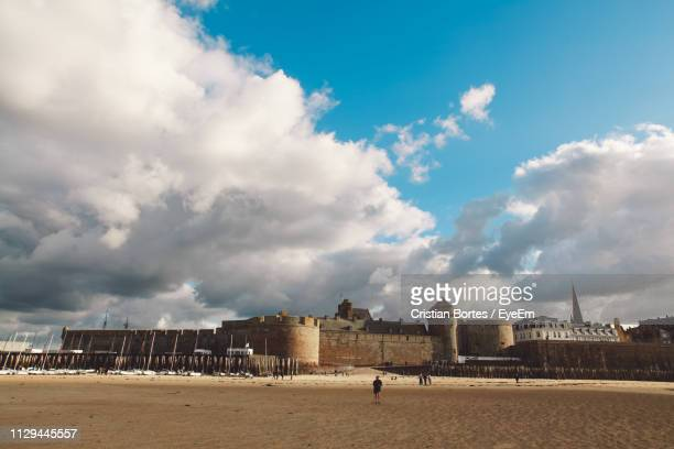 Fort At Beach Against Cloudy Sky