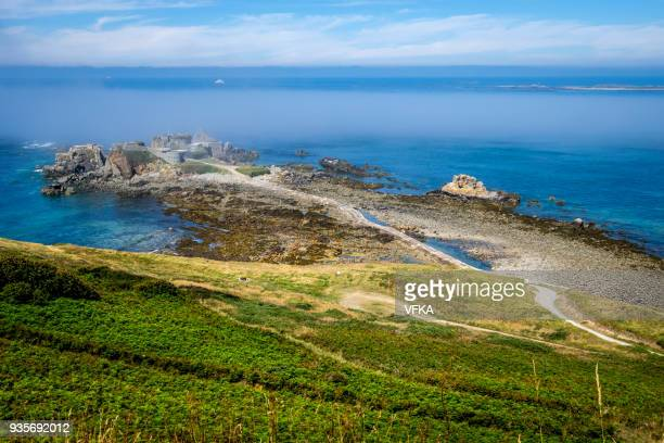 fort clonque in the morning fog, alderney, guernsey, channel islands - isola di guernsey foto e immagini stock