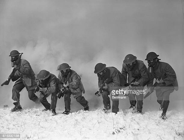 Fort Dix Boys Get a Snifter of Gas Fort Dix New Jersey Soldiers of the 44th Division are shown racing through a smoke screen to which a little tear...