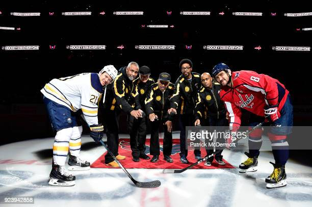 Fort Dupont hockey coaches Hank Lee John Connor Neal Henderson Robert Primus and Ralph Featherstone participate in a ceremonial puck drop with Kyle...