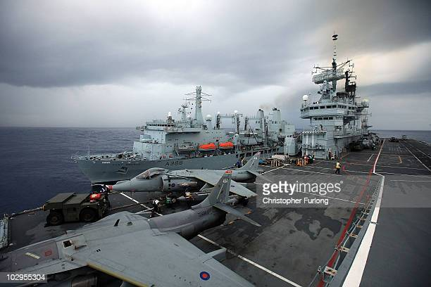 Fort George comes alongside HMS Ark Royal to replenish the ship at sea during Exercise Auriga on July 14 2010 at sea in Onslow Bay near North...