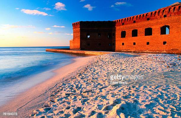 fort jefferson and beach at sunset, garden key, dry tortugas national park, florida, united states of america, north america - dry tortugas stock pictures, royalty-free photos & images