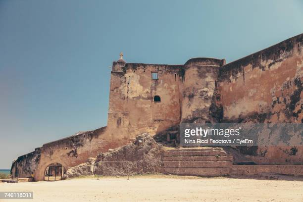fort jesus against clear sky - mombasa stock photos and pictures