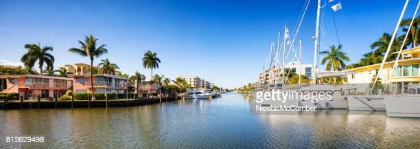 fort lauderdale florida canal panorama with houses and yachts - fort lauderdale stock pictures, royalty-free photos & images