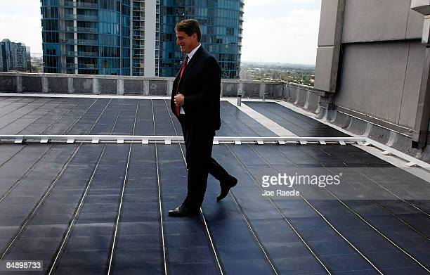 Fort Lauderdale Mayorelect John P Jack Seiler walks across a solar roof at its unveiling at Florida Atlantic University on February 18 2009 in Fort...