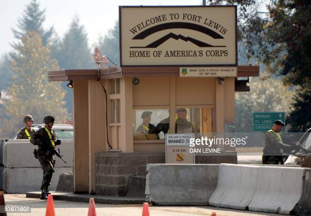 Fort Lewis Army base soldiers keep guard at an entry on 24 October of 2002 in Tacoma Washington Suspected sniper John Allen Muhammad served as a...