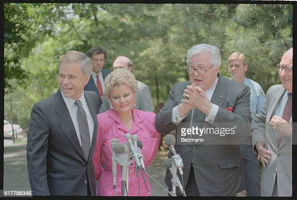 Evangelist Jim Bakker holds a Bible and a flower arrangement as he arrives at the home of Mary Davidson at Heritage USA here late June 13th Bakker...