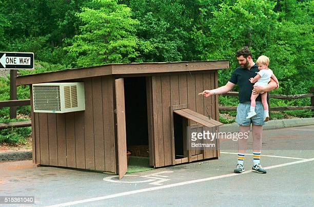 Former PTL employees Paul Marrin and his son Matthew look over Jim and Tammy Bakker's airconditioned doghouse that has been moved to the grounds of...