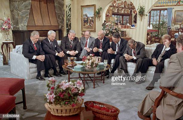 Fort Mill South Carolina Reverend Jerry Falwell leads the new PTL Board of Directors in a prayer for Jim and Tammy Bakker during a taping of the Jim...