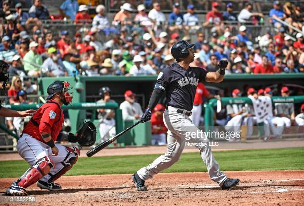 New York Yankees Aaron Hicks hits an RBI double in the second inning of a spring training game against the Boston Red Sox at Jet Blue Park at Fenway...