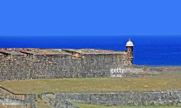 fort san cristobal (castillo san cristobal) and sentry box (garitas) against the caribbean sea - old san juan, puerto rico - old san juan wall stock photos and pictures