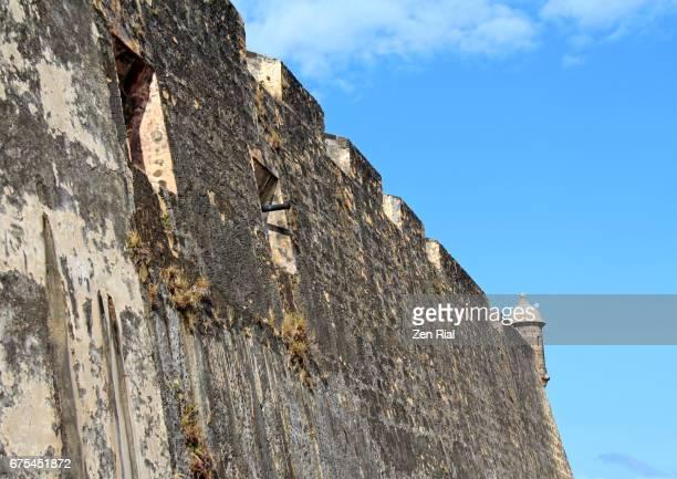 fort san cristobal (castillo san cristobal) wall and sentry - old san juan, puerto rico - old san juan wall stock photos and pictures