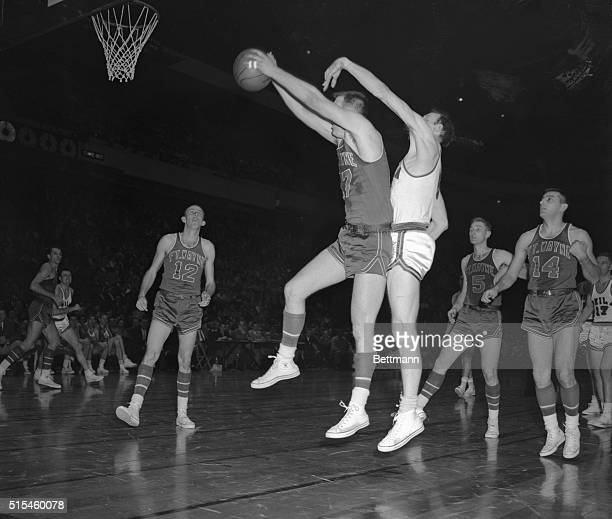 Fort Wayne's Bob Houbregs makes a bid for the basket as Philadelphia's Neil Johnston attempts to block in the pro basketball game at Madison Square...
