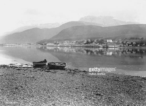 Fort William from the shores of Loch Linnhe Scotland with Ben Nevis behind the town circa 1920