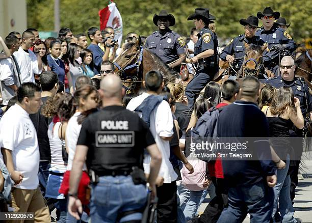 Fort Worth police attempt to regain control of a crowd of Fort Worth students that filled the streets of downtown Fort Worth Texas Tuesday March 28...