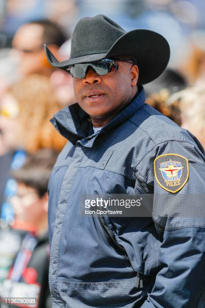 Fort Worth police officer patrols the crowd prior to the start of the Monster Energy NASCAR Cup Series O'Reilly Auto Parts 500 on March 31 2019 at...