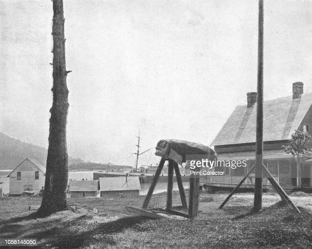 Fort Wrangell Alaska USA circa 1900 Tlingit wooden carving on the shore of Wrangell Island Fort Wrangell was established in 1868 aafter the US...