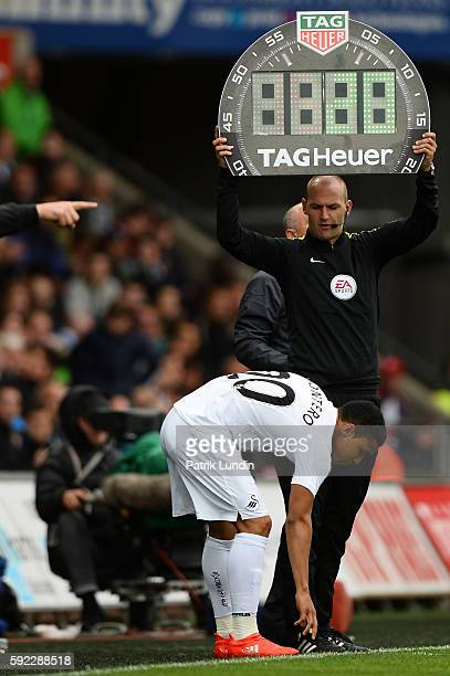 Forth official Robert Madley holds up the substitution board during the Premier League match between Swansea City and Hull City at Liberty Stadium on...