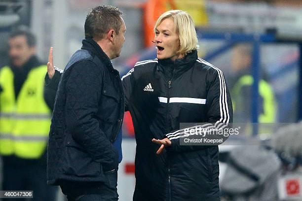 Forth referee Bibiana Steinhaus talks to head coach Andre Breitenreiter of Paderborn during the Bundesliga match between SC Paderborn and SC Freiburg...