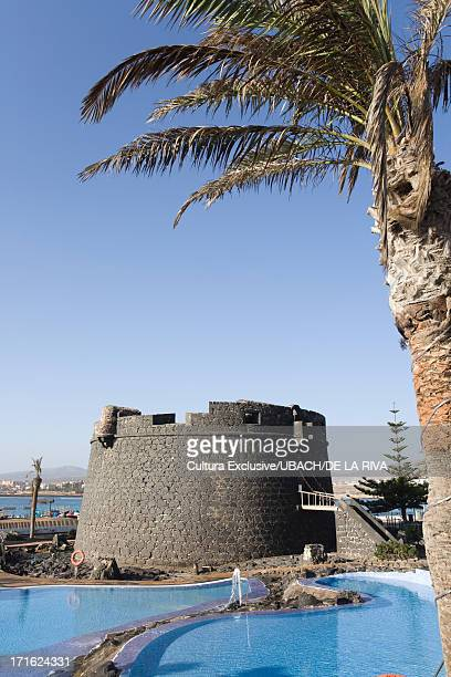 Fortified tower and pool, Caleta de Fuste beach, Antigua, Fuerteventura, Canary Islands, Spain