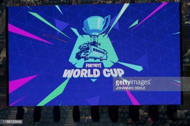 A Fortnite Wold Cup logo is seen on a TV screen during the Duos competition at the 2019 Fortnite World Cup July 27 2019 inside of Arthur Ashe Stadium...