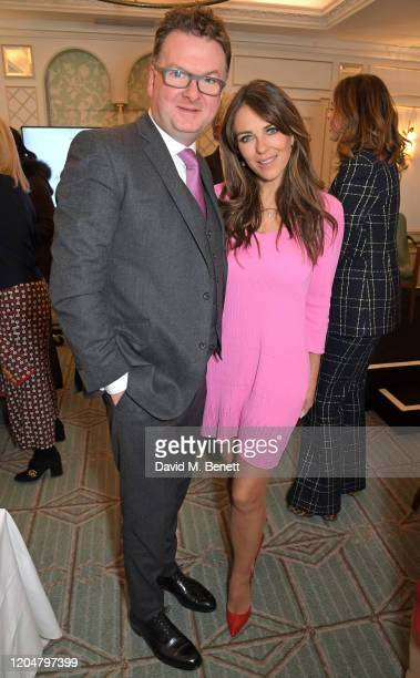 Fortnum & Mason CEO Ewan Venters and Elizabeth Hurley attend Turn The Tables 2020 hosted by Tania Bryer and James Landale in aid of Cancer Research...