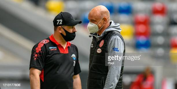 Fortuna Duesseldorf Head Coach Uwe Roesler and Paderborn Head Coach Steffen Baumgart are seen prior to during the Bundesliga match between Fortuna...