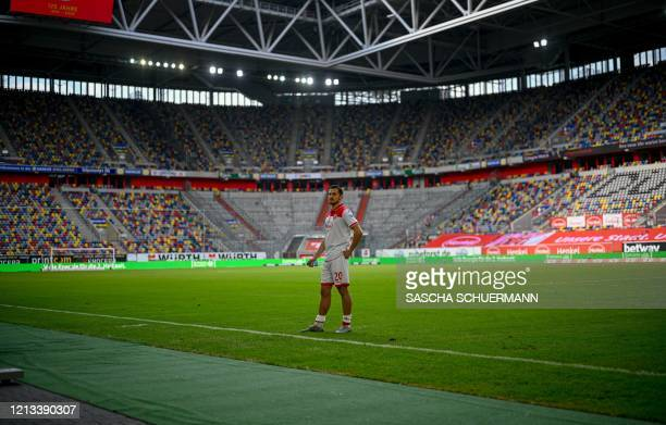 Fortuna Duesseldorf's German forward Steven Skrzybski stands in front of the empty stands as he gives an interview after the German first division...