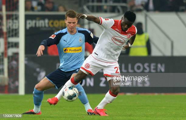 Fortuna Duesseldorf's Ghanaian forward Nana Ampomah and Moenchengladbach's Swiss defender Nico Elvedi vie for the ball during the German first...