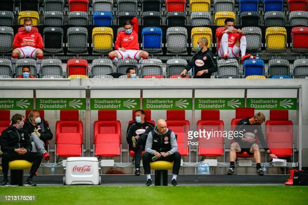 Fortuna Duesseldorf's head coach Uwe Roesler sits on the team bench on the sideline during the Bundesliga match between Fortuna Duesseldorf and SC...