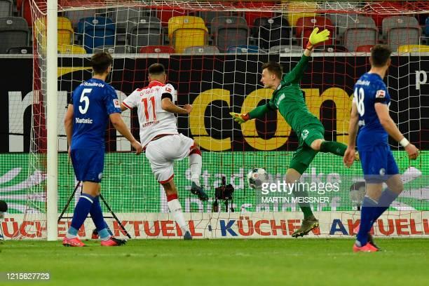 Fortuna Duesseldorf's Turkish forward Kenan Karaman scores his side's second goal during during the German first division Bundesliga football match...